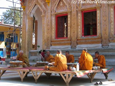 Monks eating meal